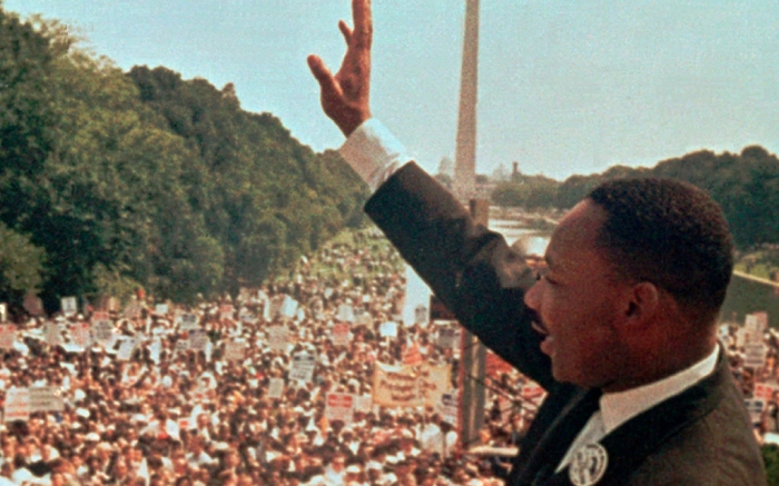 """FILE - In this Aug. 28, 1963, file photo, the Rev. Martin Luther King Jr. acknowledges the crowd at the Lincoln Memorial for his """"I Have a Dream"""" speech during the March on Washington. During the critical era of the 1950s and '60s, King, who led the 250,000 strong March on Washington, and Malcolm X were colossal 20th century figures, representing two different tracks: mass non-violent protest and getting favorable outcomes """"by any means necessary."""" (AP Photo/File)"""
