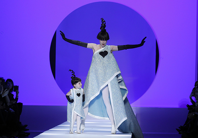 Model Coco Rocha, right, poses with her 2-year-old daughter Ioni Conran wearing creations for the Jean Paul Gaultier Haute Couture Spring-Summer 2018 fashion collection presented in Paris, Wednesday, Jan. 24, 2018. (AP Photo/Francois Mori)