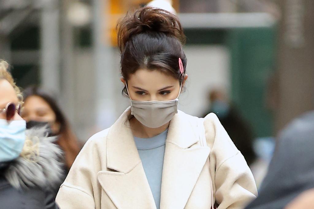 Selena Gomez Elevates Fuzzy Sweatpants & $50 Puma Sneakers With Chic Cream Overcoat in NYC