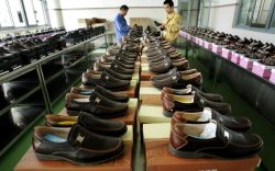 Workers check shoes before shipping out