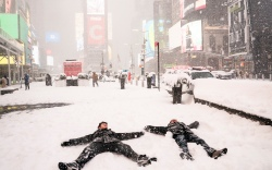Guy Torres, right, makes snow angels