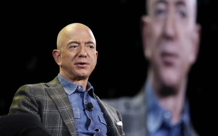 """FILE - In this June 6, 2019, file photo Amazon CEO Jeff Bezos speaks at the the Amazon re:MARS convention in Las Vegas. Washington state's richest residents, including Bezos and Bill Gates, would pay a wealth tax on certain financial assets worth more than $1 billion under a proposed bill whose sponsor says she is seeking a fair and equitable tax code. Under the bill, starting Jan. 1, 2022, for taxes due in 2023, a 1% tax would be levied on """"extraordinary"""" assets ranging from cash, publicly traded options, futures contracts, and stocks and bonds. (AP Photo/John Locher, File)"""