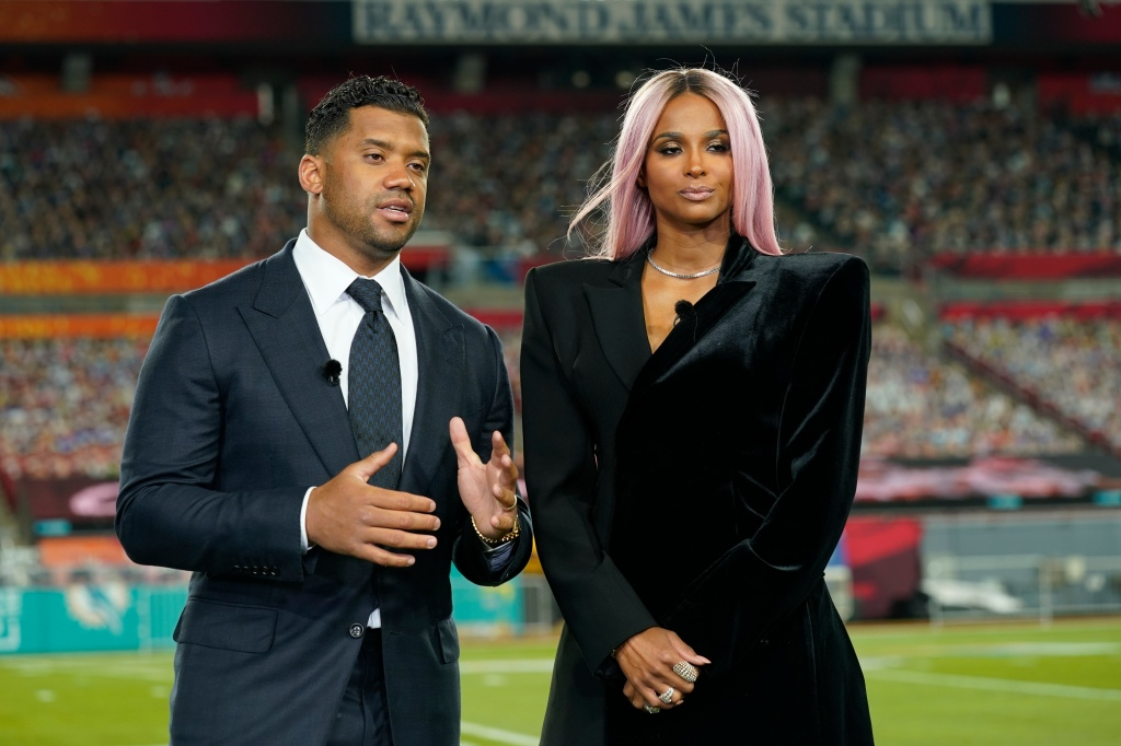 Seattle Seahawks quarterback Russell Wilson and his wife Ciara talk make a statement after Wilson won the Walter Payton NFL Man of the Year awards at the NFL Honors ceremony as part of Super Bowl 55 Friday, Feb. 5, 2021, in Tampa, Fla. (AP Photo/Charlie Riedel)