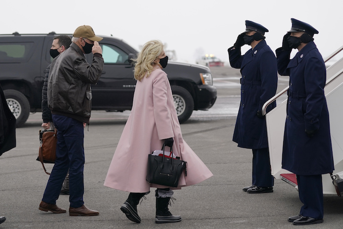 President Joe Biden and first lady Jill Biden, arrives to board Air Force One at Hagerstown Regional Airport, Monday, Feb. 15, 2021, in Hagerstown, Md. They had spent the weekend at Camp David. (AP Photo/Evan Vucci)