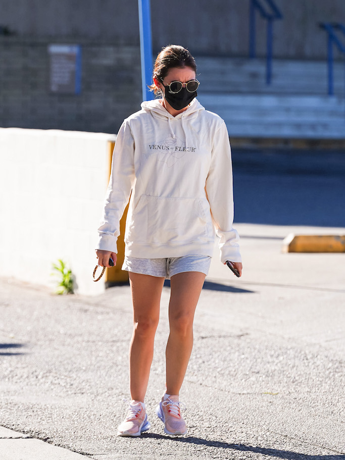 Lucy Hale in Venus et Fleur hoodie and coral Nike Air Max 270 sneakers