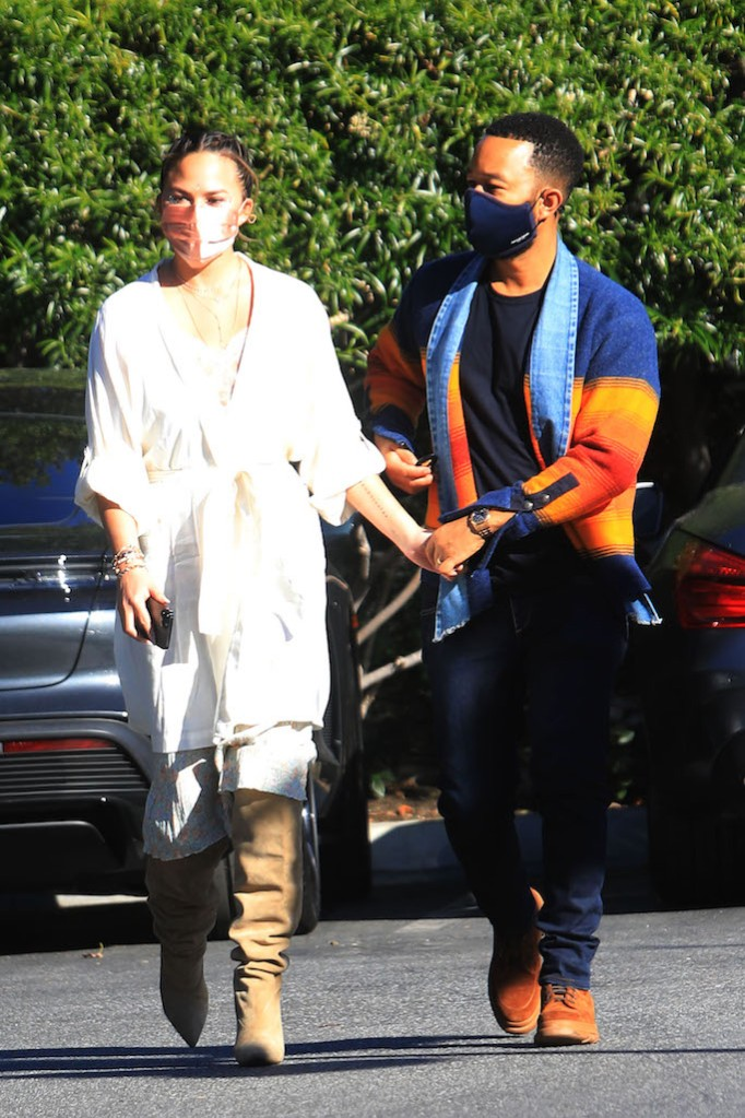 Chrissy Teigen and John Legend whte robe grocery shopping tall boots