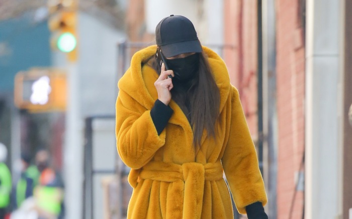 Model Irina Shayk looks busy in the phone during a walk
