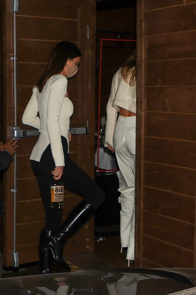 Kendall Jenner brings a bottle of her new tequila brand 818 along to Craig's as she enjoys dinner with Justin and Hailey Bieber, but Justin leaves the girls to party as he makes an early exit. 19 Feb 2021 Pictured: Kendall Jenner brings a bottle of 818 as she enjoys dinner with the Biebers. Photo credit: Rachpoot/MEGA TheMegaAgency.com +1 888 505 6342 (Mega Agency TagID: MEGA734538_009.jpg) [Photo via Mega Agency]