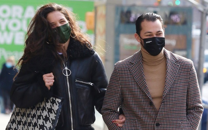 Katie Holmes is all smiles with Emilio Vitolo Jr. as they walk arm in arm during a romantic stroll in NYC.