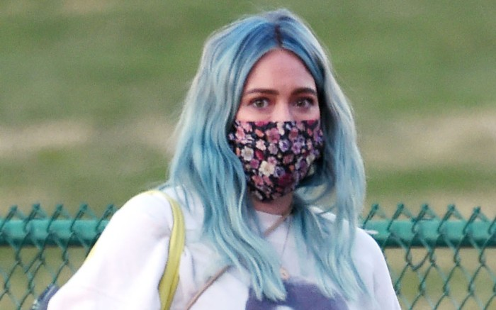 EXCLUSIVE: Hilary Duff takes her St. Bernard puppy for a walk in the park while showing off her baby bump in an Elvis top