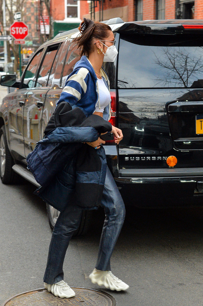 Bella Hadid wears an open sweatshirt and bares her belly when seen visiting a friends apartment in the West VillagePictured: Bella Hadid Ref: SPL5213382 260221 NON-EXCLUSIVE Picture by: Wylde / SplashNews.com Splash News and Pictures USA: +1 310-525-5808 London: +44 (0)20 8126 1009 Berlin: +49 175 3764 166 photodesk@splashnews.com World Rights