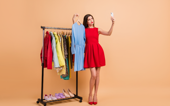 Woman modelling clothes from an assortment rail
