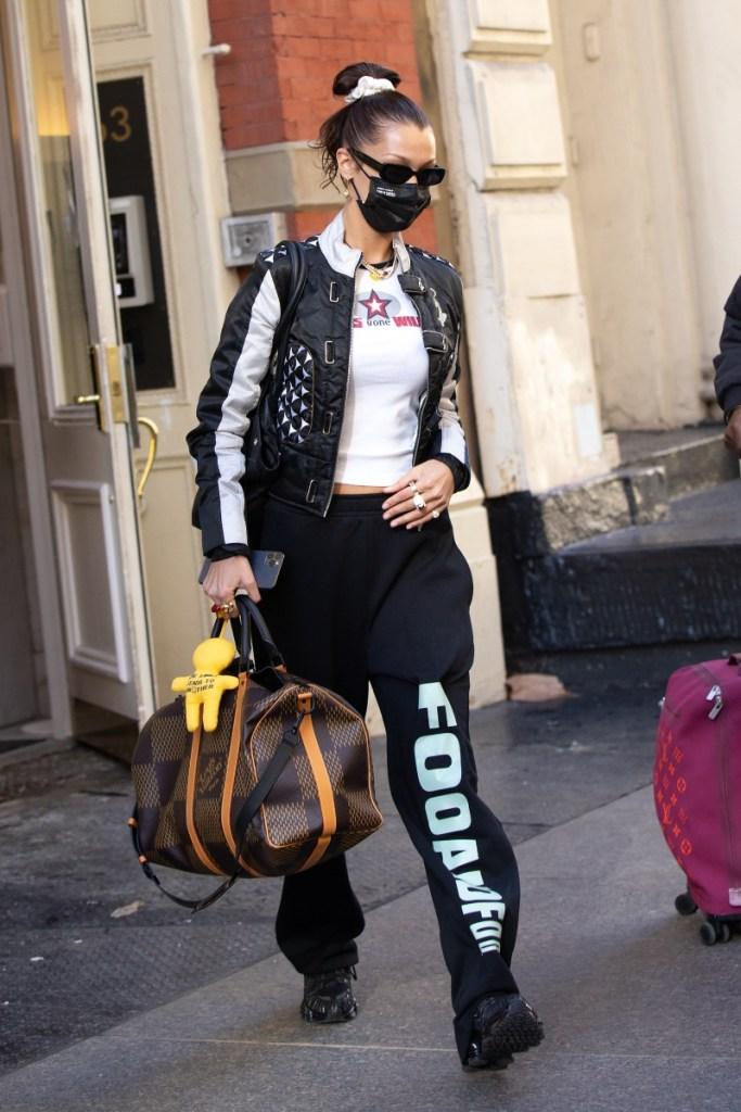 bella hadid, sweatpants, shirt, jacket, sunglasses, louis vuitton, airport, sneakers, prada, nyfw