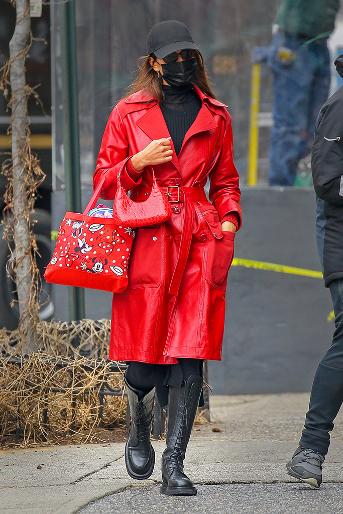 Irina Shayk looks fashionable while wearing a red and black ensemble as walking around with a red Minnie Mouse and a red handbag in New York CityPictured: Irina Shayk Ref: SPL5208792 270121 NON-EXCLUSIVE Picture by: Felipe Ramales / SplashNews.com Splash News and Pictures USA: +1 310-525-5808 London: +44 (0)20 8126 1009 Berlin: +49 175 3764 166 photodesk@splashnews.com World Rights