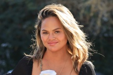 Chrissy Teigen Boldly Turns a Blazer Into a Dress With a Little Help From Her Fishnet Heels