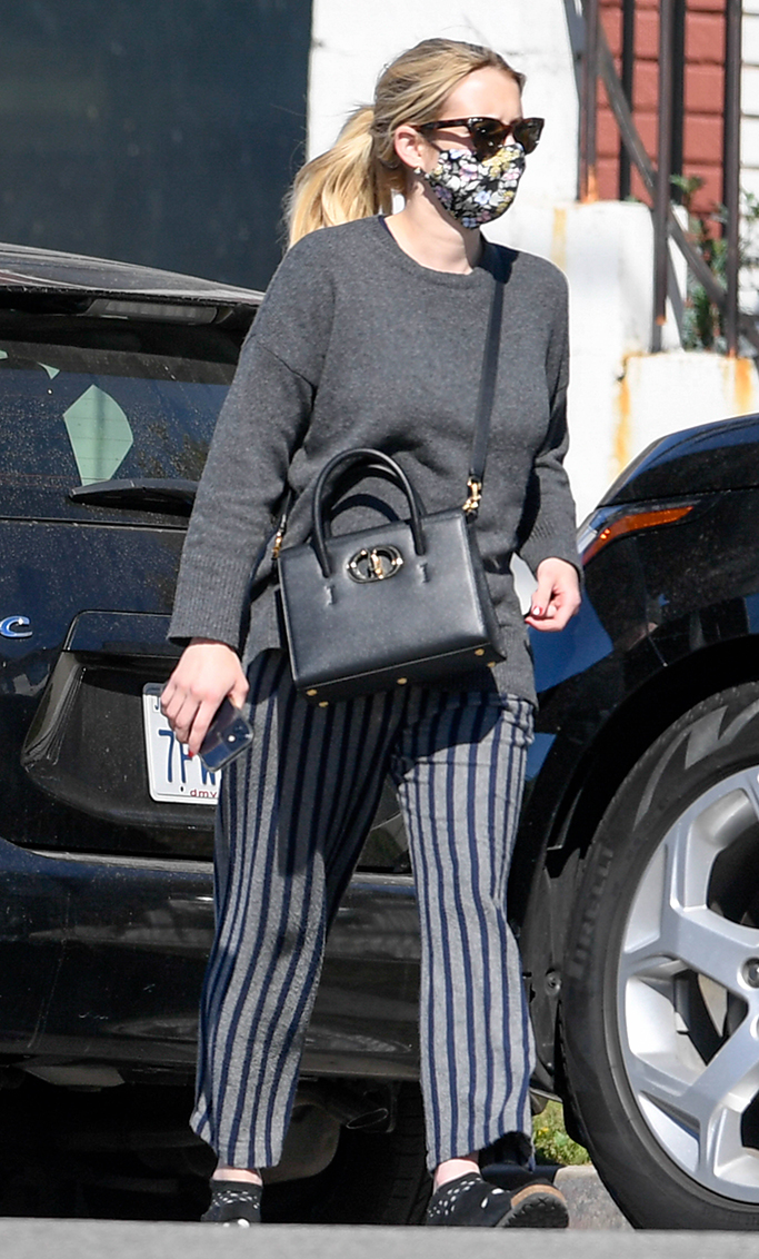 Emma Roberts picks up breakfast with her mother. 20 Feb 2021 Pictured: Emma Roberts. Photo credit: MEGA TheMegaAgency.com +1 888 505 6342 (Mega Agency TagID: MEGA734659_002.jpg) [Photo via Mega Agency]