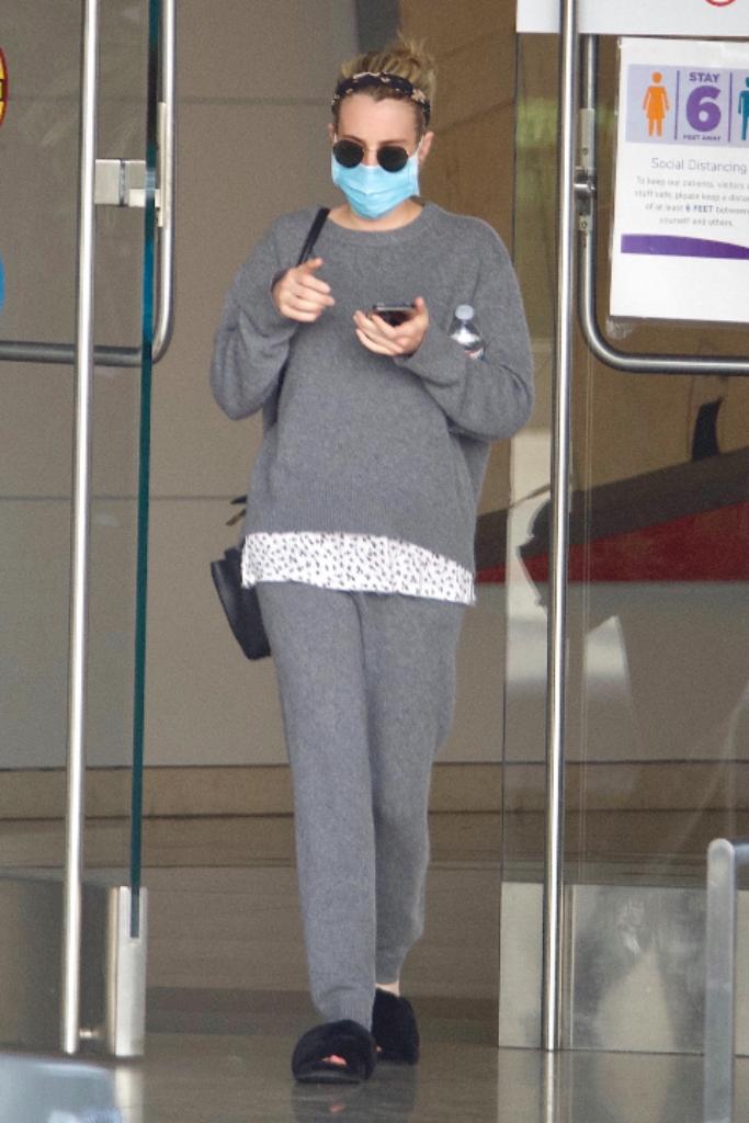 emma roberts, gray sweater set, lounge set, black fuzzy slippers