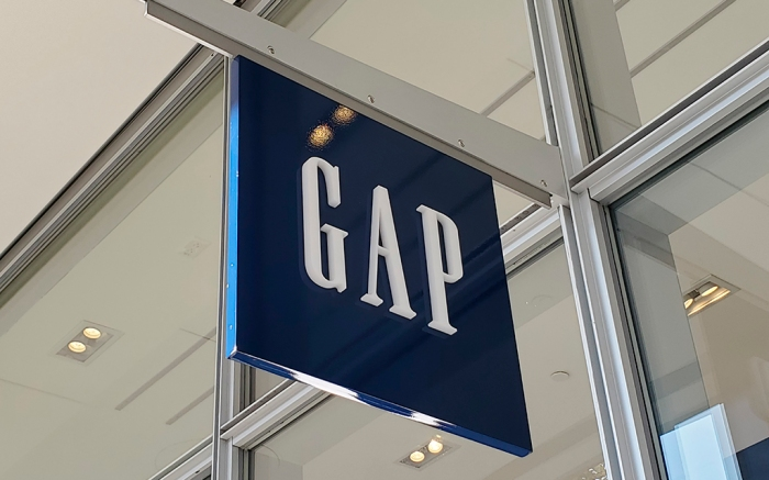 Low-angle shot of a Gap sign hanging above the clothing store entrance in San Ramon, California, December 6, 2020. (Photo by Smith Collection/Gado/Sipa USA)(Sipa via AP Images)