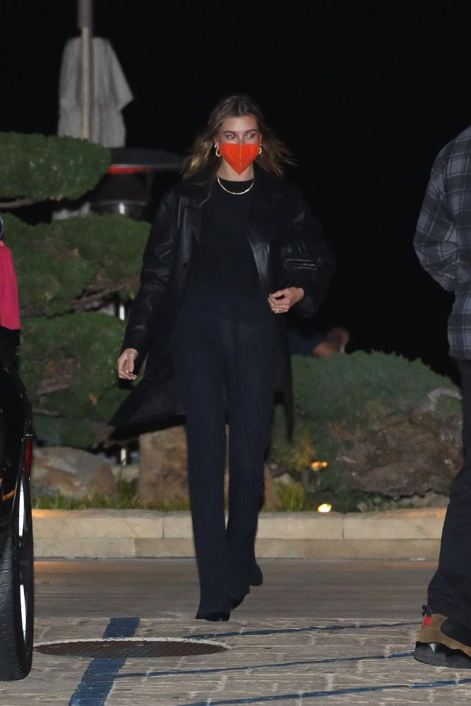 hailey baldwin, shirt, leather coat, jacket, pants, ribbed pants, sheer, orange face mask, nobu malibu, la