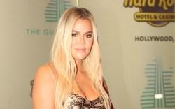 Khloe Kardashian, snakeskin dress, black bag