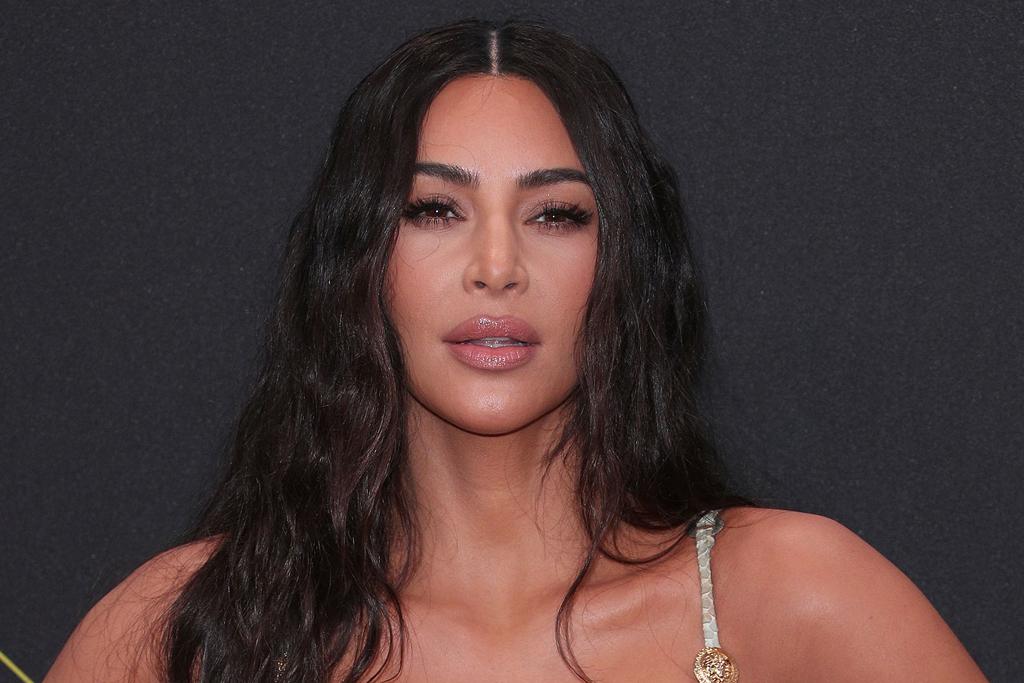 Kim Kardashian's Green Bikini & Sporty 'Ugly' Sandals Bring the Monochrome Trend to the Beach - Footwear News