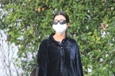 Kourtney Kardashian Demonstrates How to Achieve a Rocker Aesthetic With Leather Trench & Chunky Shoes