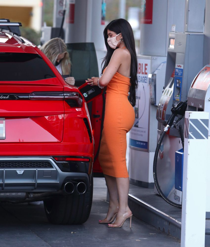 kylie jenner, orange dress, ribbed dress, midi dress, gas station, skims mask, heels, see through sandals, clear, la