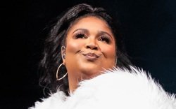 lizzo, catsuit, boots