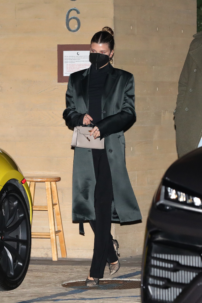 sofia richie, black turtleneck, black pants, green satin coat, lace heels