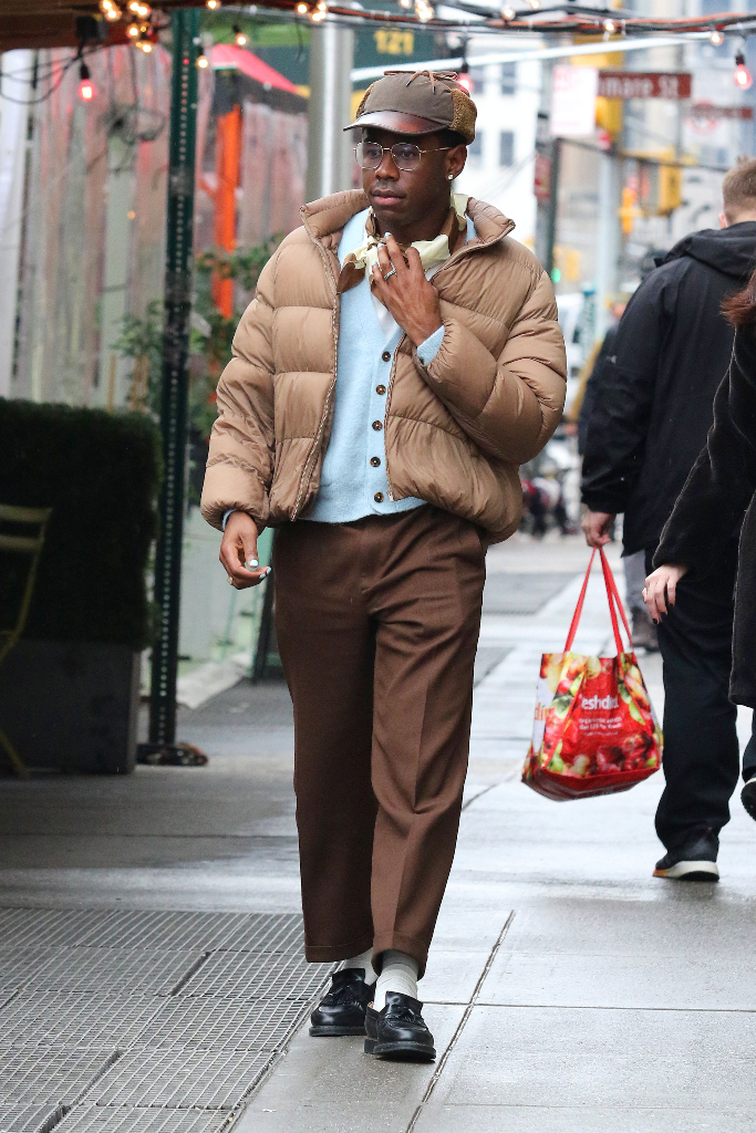 Tyler the Creator, puffer coat, dress pants, loafers