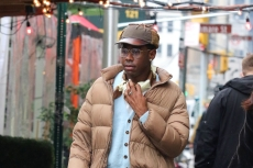 Tyler the Creator Gives the Puffer Trend a Preppy Twist With Cuffed Slacks & Loafers