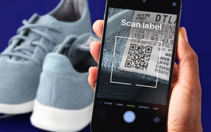 Someone scanning the QR code of