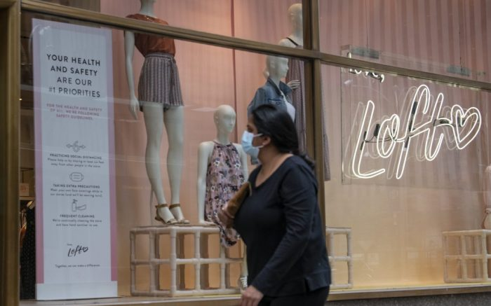August 22, 2020: A women views The health and safety requirements in the front window of The Loft store located on 6th Avenue and 48th Street prior to entering while wearing a PPE mask due to the Covid-19 pandemic in Manhattan, New York. Mandatory credit: Kostas Lymperopoulos/CSM (Credit Image: © Kostas Lymperopoulos/CSM via ZUMA Wire) (Cal Sport Media via AP Images)