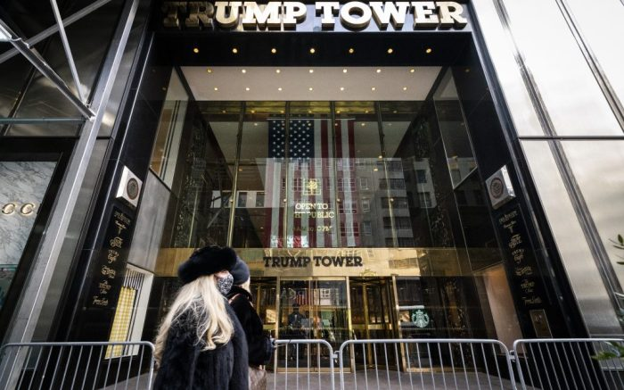 Pedestrians pass security barricades in front of Trump Tower, Wednesday, Feb. 17, 2021, in New York. Former President Donald Trump owns a penthouse condominium in the skyscraper and the Trump Organization has its headquarters here. (AP Photo/John Minchillo)