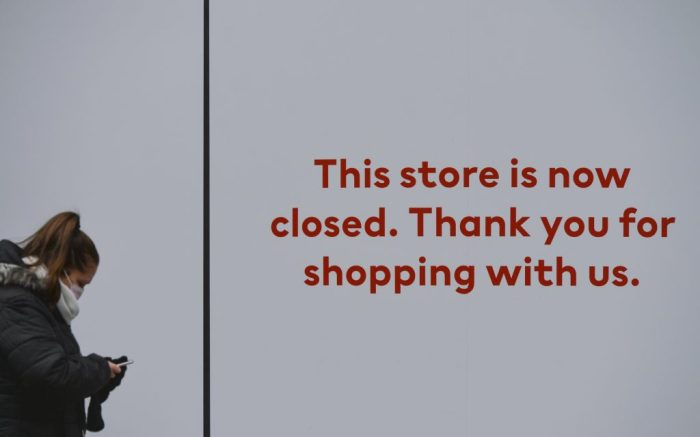 A woman wearing a face mask walks by a closed store window in Henry Steet, Dublin, during Level 5 Covid-19 lockdown. On Thursday, 4 March, 2021, in Dublin, Ireland. (Photo by Artur Widak/NurPhoto via AP)