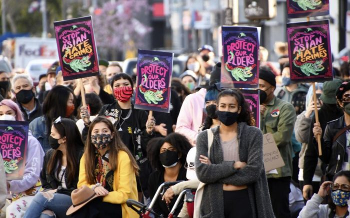 People stage a protest in Los Angeles on March 13, 2021, against anti-Asian hate crimes.