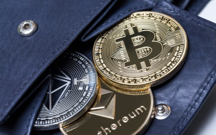 Picture of bitcoin and ethereum currency inside wallet