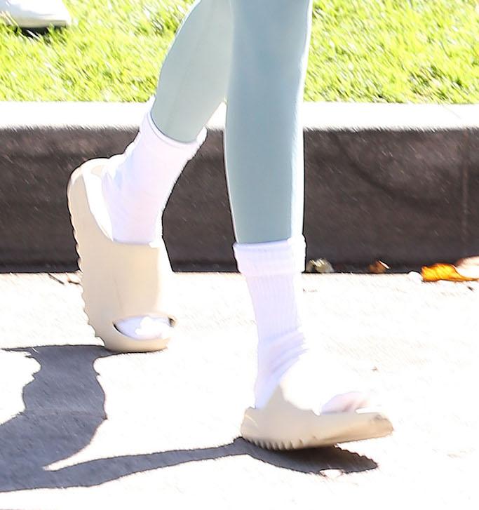 Kendall Jenner, pilates, blue workout set, alo yoga, yeezy, yeezy slides, la
