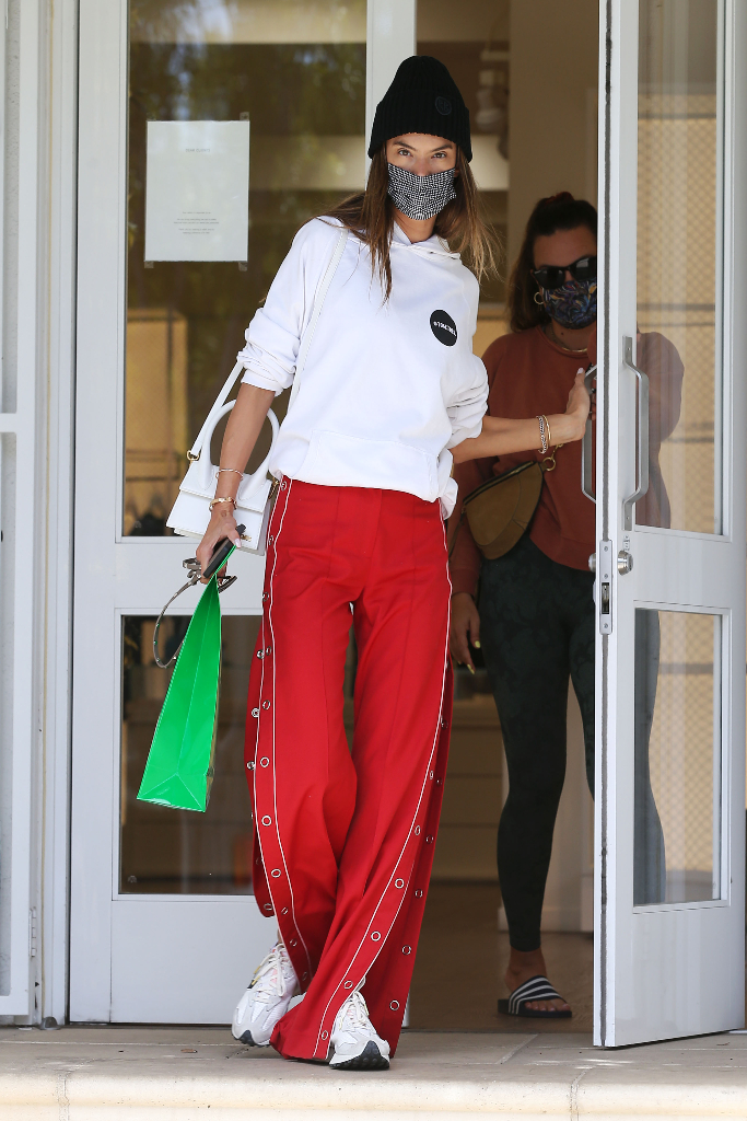 alessandra ambrosio, hoodie, red track pants, new balance sneakers