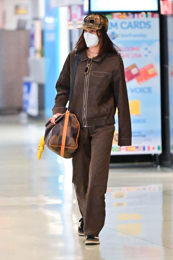 Bella Hadid, brown jacket, pants, Travis Scott Air Jordans
