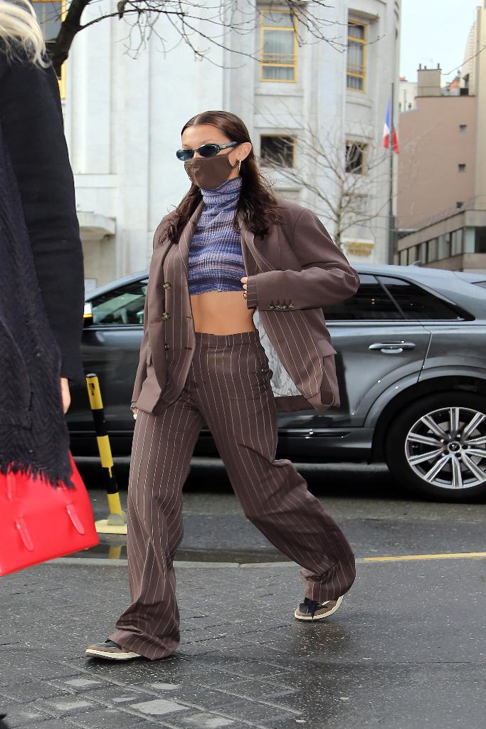 bella hadid, sweater, striped suit, air jordan 1 low sneakers