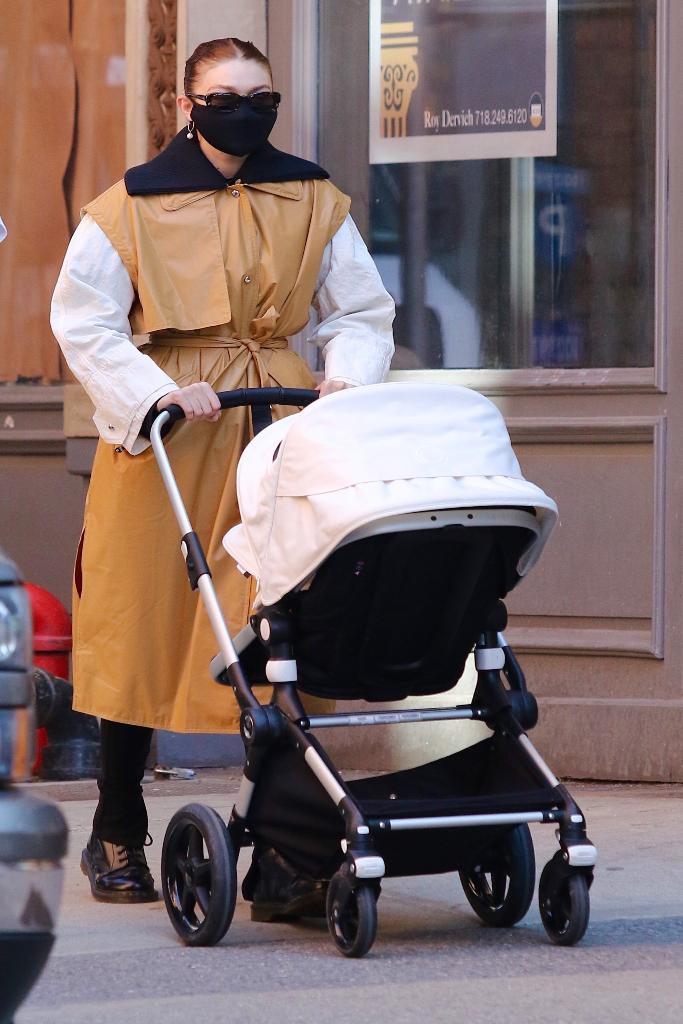gigi hadid, camel leather coat, black pants, brogues