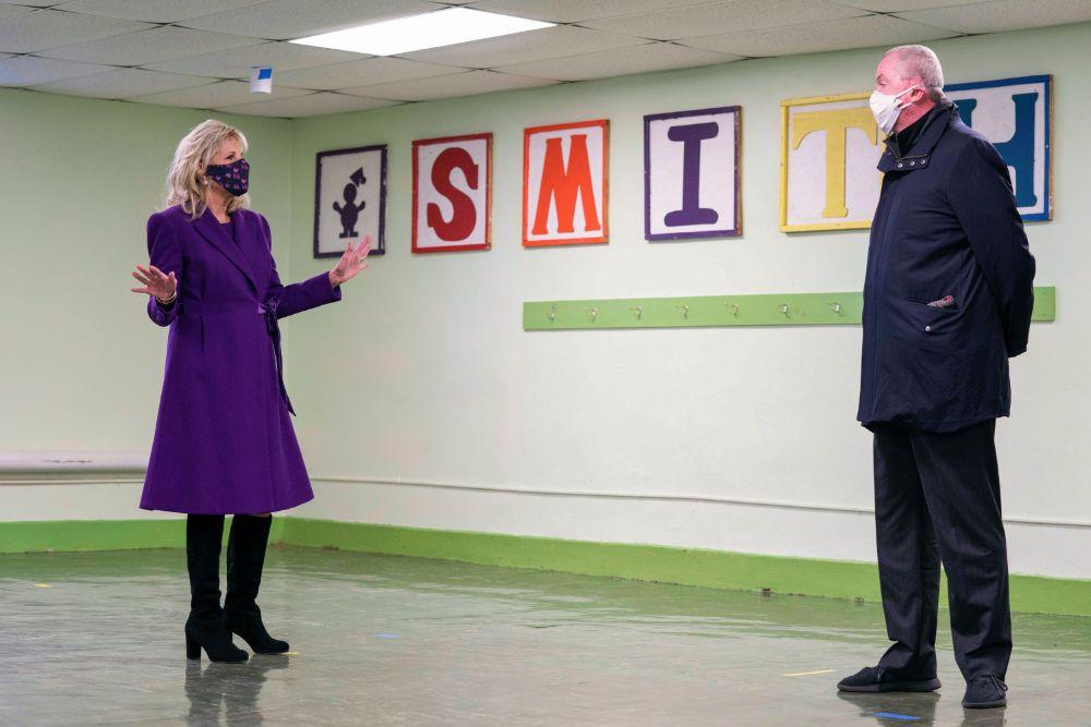 jill biden, purple coat, dress, knee-high boots, new jersey, school, teacher, tour