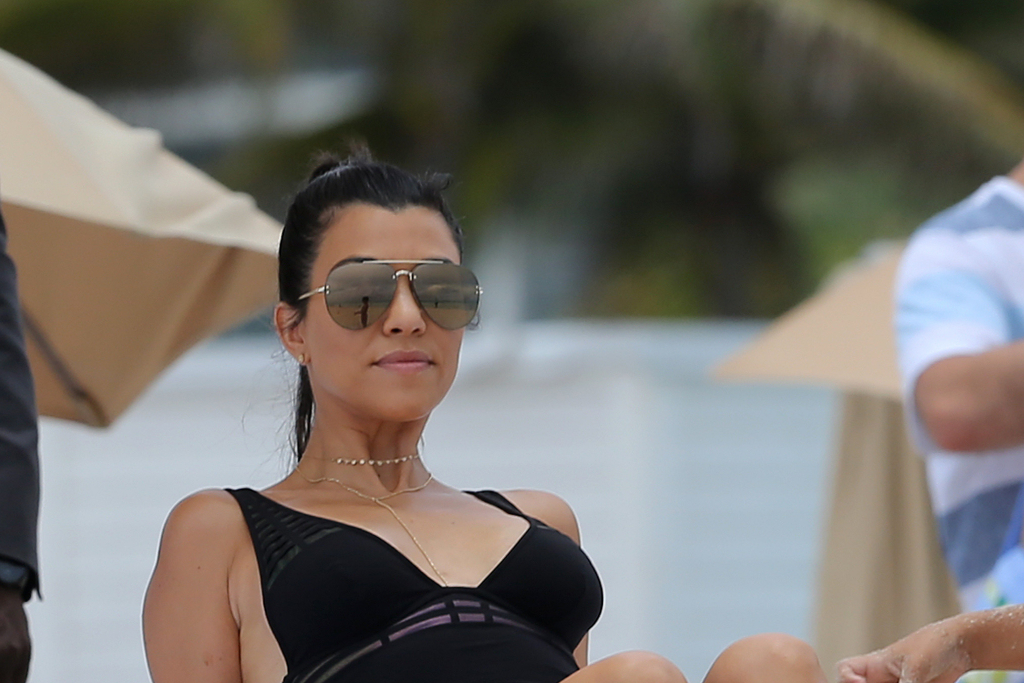 Kourtney Kardashian Goes Full Burlesque in a Corset, Thigh-High Stockings & Strappy Heels for Dolce & Gabbana