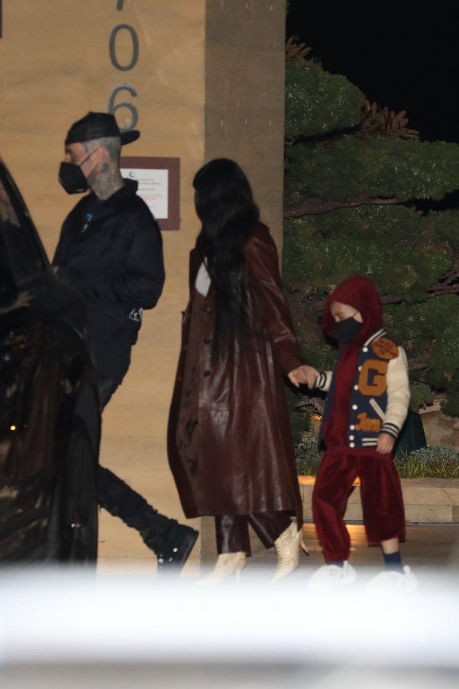 kourtney kardashian, leather pants, coat, sheer shirt, travis barker, reign disick, la