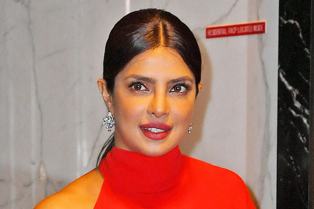 Priyanka Chopra Goes Red Hot in a Flowing Gown & Tights-Turned-Boots for 'Spaceman' - Footwear News