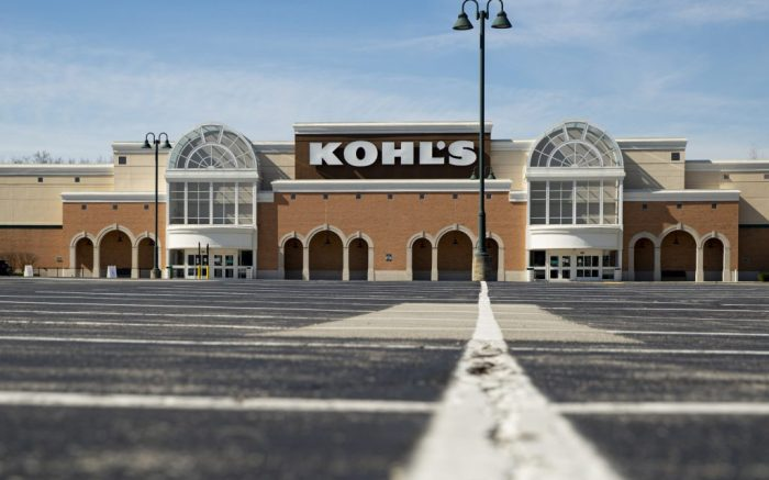 An empty parking outside a closed Kohl's store is shown in Indianapolis, Thursday, April 2, 2020. Kohl's is fighting back against an investor group's efforts to take control of the department store chain's board, arguing that it would derail its progress and momentum. The response, issued Monday, Feb. 22, 2021 comes after the investor group said it had nominated nine members for Kohl's board of directors as it looks to boost the company's stock and its financial performance. The group owns a 9.5% stake in Kohl's. (AP Photo/Michael Conroy, file)