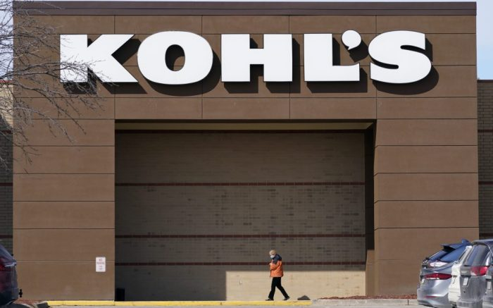 FILE - In this Feb. 25, 2021 file photo a woman arrives at a Kohl's store in West Des Moines, Iowa. Kohl's Corp. says it's adding two independent directors to its board as part of an agreement it struck with a key activist investor group that has been fighting to exert more control. (AP Photo/Charlie Neibergall, File)