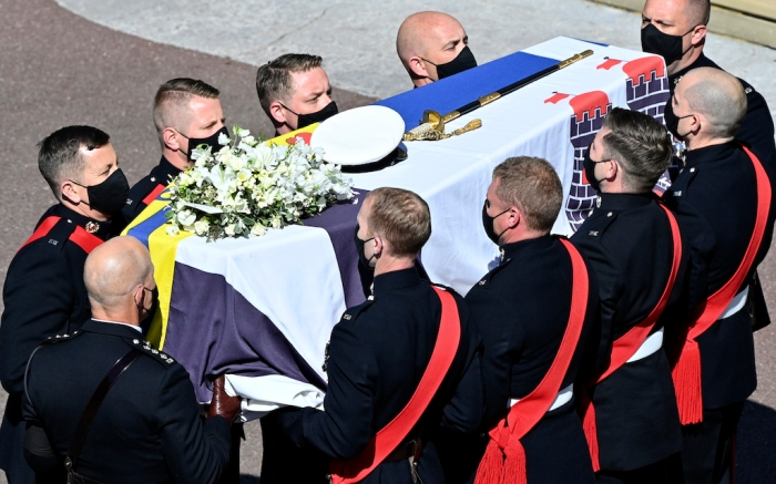 Pall bearers carry the coffin arriving at St George's Chapel for the funeral of Britain's Prince Philip inside Windsor Castle in Windsor, England, Saturday, April 17, 2021. Prince Philip died April 9 at the age of 99 after 73 years of marriage to Britain's Queen Elizabeth II. (Justin Tallis/Pool via AP)