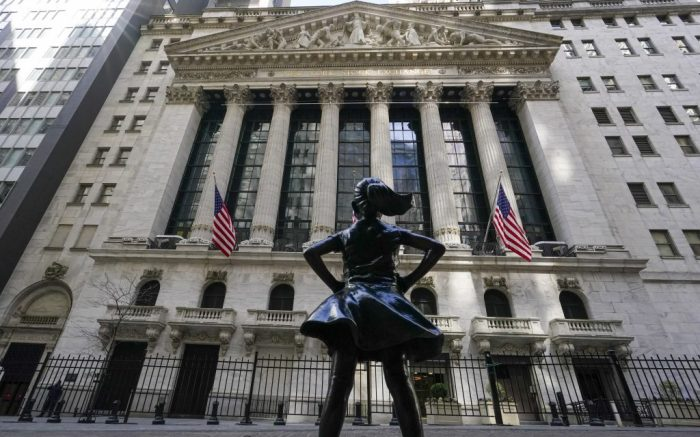 FILE - In this March 23, 2021 file photo, the Fearless Girl statue stands in front of the New York Stock Exchange in New York's Financial District.  Stocks are opening modestly higher on Wall Street at the beginning of another heavy week for earnings reports from big U.S. companies. The S&P 500 added 0.2% in early trading Monday, April 26. (AP Photo/Mary Altaffer, File)